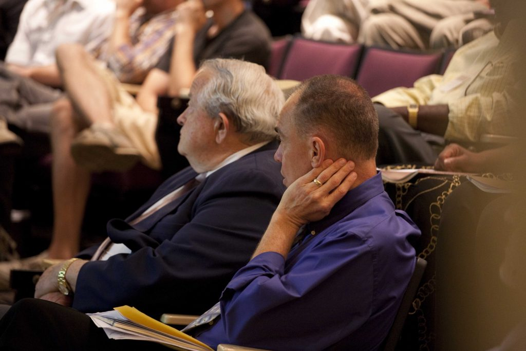 David Fleer and Tom Olbricht listening to a speaker at the 2010 Christian Scholars' Conference